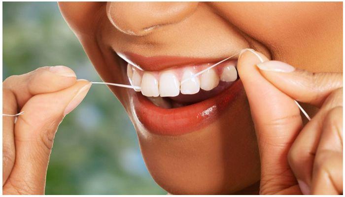 Применения зубной нити